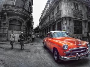 Orange car in the less vibrant parts of Old Havana.